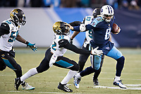 NASHVILLE, TN - DECEMBER 31:  Marcus Mariota #8 of the Tennessee Titans runs the ball and stiff arms Barry Church #42 of the Jacksonville Jaguars at Nissan Stadium on December 31, 2017 in Nashville, Tennessee.  The Titans defeated the Jaguars 15-10.  (Photo by Wesley Hitt/Getty Images) *** Local Caption *** Marcus Mariota; Barry Church