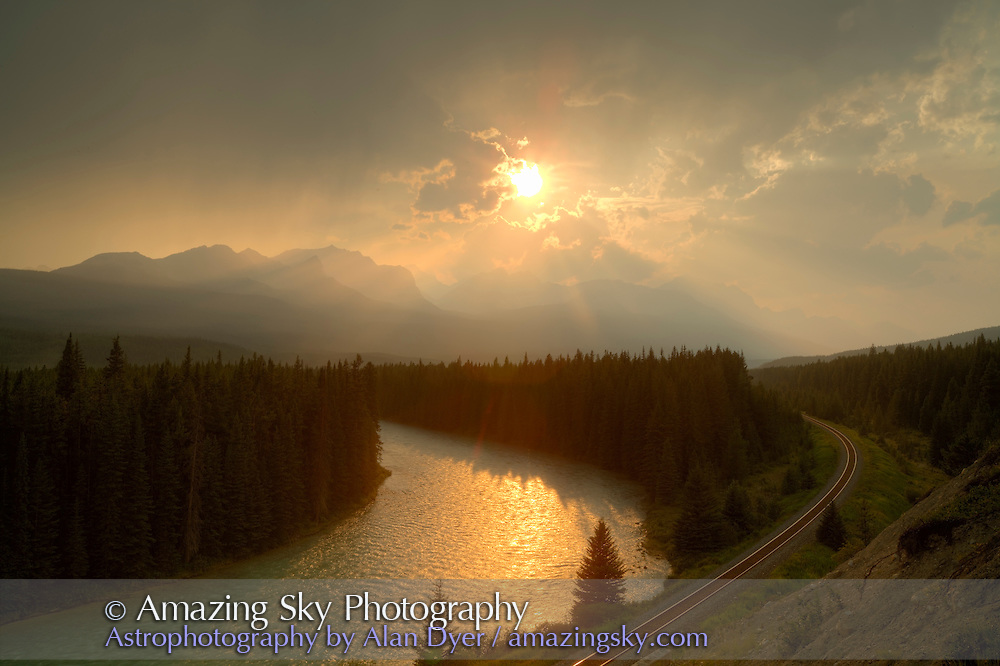 Setting Sun and crepuscular rays from Storm Mountain Viewpoint on Bow Valley Parkway, Banff National Park, Alberta.