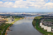 Nederland, Zuid-Holland, Rotterdam, 09-05-2013; Oude Maas tussen Spijkeniss en Hoogvliet (re). Botlek aan de horizon.<br /> River Old Meuse, Rotterdam region.<br /> <br /> luchtfoto (toeslag op standard tarieven)<br /> aerial photo (additional fee required)<br /> copyright foto/photo Siebe Swart