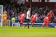 Luke Summerfield wheels away in celebration after his penalty brings the teams level during the Capital One Cup match between York City and Bradford City at Bootham Crescent, York, England on 11 August 2015. Photo by Simon Davies.