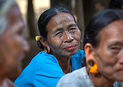 The tattooed women of Burma: Extraordinary photographs show elaborate facial inkings of the tribe whose traditions are dying out<br /> <br /> Their faces covered in elaborate black patterns and, in some cases, totally dark with ink, these smiling villagers are some of Burma's last surviving tattooed women.<br /> <br /> A custom that, according to legend, began when an ancient king tried to make slaves of the women, the inkings were first intended to repel incomers and then became a symbol of beauty.<br /> But with younger people increasingly reluctant to be inked for fear of ridicule and for fear of the heavy fines imposed by the ruling military junta, Burma's tattooing tradition is on borrowed time and could disappear within a generation.<br /> <br /> As a result, few women now have the markings, with the majority of those who do living hidden away in the mountainous Chin, Rakhine and Arakan regions - all of which were closed off to visitors until two years ago.<br /> <br /> Now an estimated 700 tourists travel to the area each year, although few are inclined to attempt the precipitous climb up to the mountain eyries of the Magan, Chin and Muun tribes.<br /> Those who do will be rewarded with a warm welcome - and a glimpse into one of Asia's oldest, and most threatened, cultures. <br /> Most of the tattooed women boast spider's web designs which, as one villager quipped 'attract the men like a spider's web catches insects'.<br /> Others bear full-face tattoos, with every part of their face covered in ink - again, a symbol of beauty. So popular did the look become, one elderly lady, Pa Late from the remote Kanpelet village, revealed that women who chose not to have it 'looked ugly to all the men'.<br /> <br /> The tattoos, which are created using thorn needles and an ink made from a mixture of cow bile, soot, plants and pig fat, are also a sign of bravery - particularly those etched on the neck, which are the most painful of all. <br /> In the past, women who tried to avoid being tattooed found themselves thrown into the family pig pen where, says Pa L
