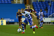 Reading Defender, Chris Gunter (2) holds off a challenge from Ipswich Town Forward, Freddie Sears (20) during the EFL Sky Bet Championship match between Reading and Ipswich Town at the Madejski Stadium, Reading, England on 9 September 2016. Photo by Adam Rivers.