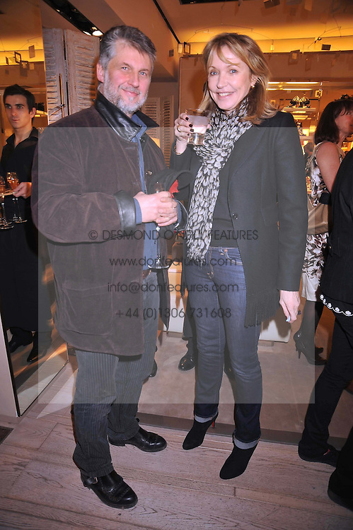 PAUL BENNY and SUE WHITELEY at a reception in aid of Children in Crisis held at the Roger Vivier store, 188 Sloane Street, London on 19th March 2009.