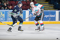 KELOWNA, CANADA - JANUARY 24:  Damon Severson #7 of the Kelowna Rockets makes a pass as Seth Swenson #21 of the Seattle Thunderbirds skates in for the check at the Kelowna Rockets on January 24, 2013 at Prospera Place in Kelowna, British Columbia, Canada (Photo by Marissa Baecker/Shoot the Breeze) *** Local Caption ***