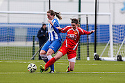Cardiff's Zoe Atkins attempts to tackle Brighton's Amy Taylor during the FA Women's Premier League match between Brighton Ladies and Cardiff City Ladies at Brighton's Training Ground, Lancing, United Kingdom on 22 March 2015. Photo by Geoff Penn.
