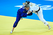 Warsaw, Poland - 2017 April 21: Tina Trstenjak from Slovenia (white) competes with Martyna Trajdos from Germany (blue) in the women&rsquo;s 63kg semifinal during European Judo Championships 2017 at Torwar Hall on April 21, 2017 in Warsaw, Poland.<br /> <br /> Mandatory credit:<br /> Photo by &copy; Adam Nurkiewicz / Mediasport<br /> <br /> Adam Nurkiewicz declares that he has no rights to the image of people at the photographs of his authorship.<br /> <br /> Picture also available in RAW (NEF) or TIFF format on special request.<br /> <br /> Any editorial, commercial or promotional use requires written permission from the author of image.
