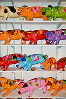 Switzerland. Springtime.  Colored pigs on shelves.
