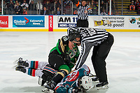 KELOWNA, CANADA - JANUARY 19:  Linesman Dustin Minty separates Noah Gregor #18 of the Prince Albert Raiders from Mark Liwiski #9 of the Kelowna Rockets on January 19, 2019 at Prospera Place in Kelowna, British Columbia, Canada.  (Photo by Marissa Baecker/Shoot the Breeze)