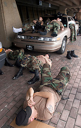 31st August, 2005. New Orleans Louisiana. Hurricane Katrina aftermath.  'Hell on earth.' The Superdome in New Orleans, Louisiana where over 20,000 refugees from hurricane Katrina are crammed into hellish conditions. Exhausted soldiers from the Louisiana National guard take a nap outside the Superdome.<br /> Photo Credit: Charlie Varley/varleypix.com