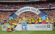 Arsenal players celebrate after the The FA Cup match between Arsenal and Aston Villa at Wembley Stadium, London, England on 30 May 2015. Photo by Phil Duncan.
