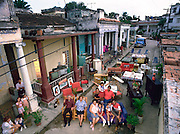 The Costa Family outside their home with all of their possessions, Havana, Cuba. Published in the book Material World, pages 106-107.