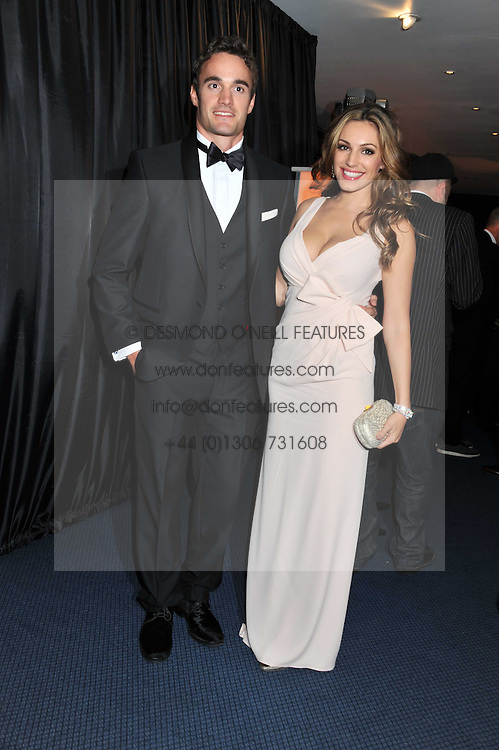 KELLY BROOK and THOM EVANS at the GQ Men of the Year 2011 Awards dinner held at The Royal Opera House, Covent Garden, London on 6th September 2011.
