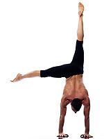 one caucasian man yoga handstand gymnastic acrobatics full length studio isolated on white background