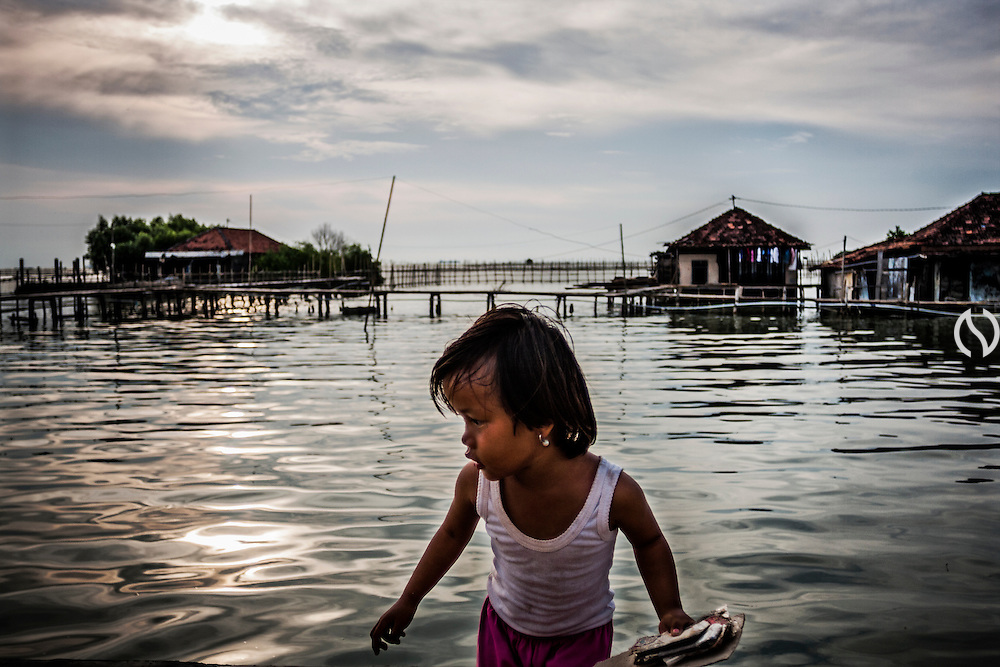 A girl is playing on a elevated road in Bedono village, near Semarang.