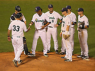 Kernels manager Jamie Burke (33) relieves pitcher Junior Carlin (13) after a three run home run during fifth inning the game between the Beloit Snappers and the Cedar Rapids Kernels at Veterans Memorial Stadium in Cedar Rapids on Saturday evening, August 25, 2012.