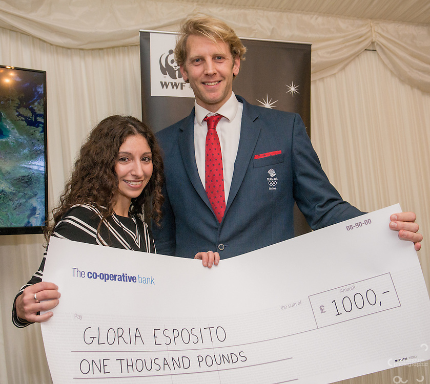 Andrew Triggs Hodge OBE presenting Community Award  Winner to Gloria Esposito during the WWF UK Earth Hour 10th Anniversary Parliamentary Reception, Terrace Pavilion, Palace of Westminster. 28th Feb. 2017