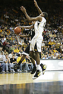 26 NOVEMBER 2007: Wake Forest guard Jeff Teague (0) and Iowa forward/center Kurt Looby (52) collide under the hoop in Wake Forest's 56-47 win over Iowa at Carver-Hawkeye Arena in Iowa City, Iowa on November 26, 2007.