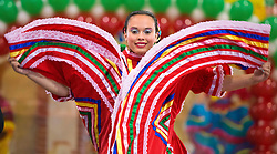 Texas A&M Ballet Folklorico Celestial member Kasaasandra Ibanez spins around and flares her dress as part of a tradition Mexican dance at Anson Jones Elementary on Tuesday during the annual Cinco de Mayo celebration at the School.