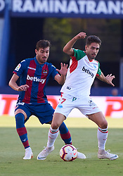 September 30, 2018 - Valencia, U.S. - VALENCIA, SPAIN - SEPTEMBER 30: Sobrino, forward of Deportivo Alaves competes the ball with Jose Campa–a, of Levante UD during the La Liga match between Levante UD and Deportivo Alaves at Estadio Ciutat de Valencia on September 30, 2018, in Valencia, Spain. (Photo by Carlos Sanchez Martinez/Icon Sportswire) (Credit Image: © Carlos Sanchez Martinez/Icon SMI via ZUMA Press)