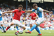 Blackburn Rovers forward Adam Armstrong (7) gets the shot away under the challenge from Charlton Athletic defender Tom Lockyer (5) during the EFL Sky Bet Championship match between Blackburn Rovers and Charlton Athletic at Ewood Park, Blackburn, England on 3 August 2019.