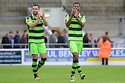 Forest Green Rovers defender Aarran Racine (21) and Forest Green Rovers defender Ethan Pinnock (16) applaud the fans 1-2 during the Vanarama National League match between Chester and Forest Green Rovers at the Deva Stadium, Chester, United Kingdom on 3 September 2016. Photo by Alan Franklin.