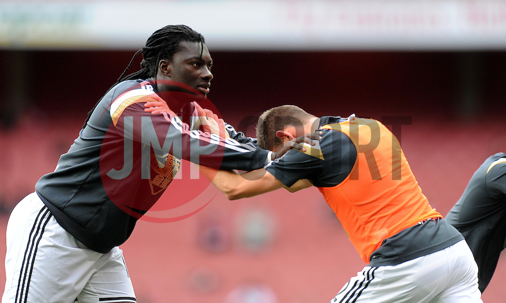 (right) Swansea City's Bafetibis Gomis warms up prior to kick off. - Photo mandatory by-line: Alex James/JMP - Mobile: 07966 386802 - 11/05/2015 - SPORT - Football - London - Emirates Stadium - Arsenal v Swansea City - Barclays Premier League