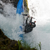 A kayaker is sucked backwards over Chaos Falls during the Slalom event of the Little White Salmon Race.