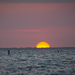 Watching the sun bid the day adieu over Sanibel Island from Ft Myers Beach