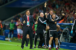 LILLE, FRANCE - Friday, July 1, 2016: Wales manager Chris Coleman celebrates his sides second goal against Belgium during the UEFA Euro 2016 Championship Quarter-Final match at the Stade Pierre Mauroy. Sean Connelly, Adam Owen, Ryland Morgans. (Pic by Paul Greenwood/Propaganda)