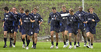 Rangers pre season training at new Auchenhowie complex on outskirts of Glasgow.<br />Pic Ian Stewart, DIGITALSPORT June 26th. 2001<br />Tore ANdre Flo trains with team mates  during a thunderstorm in Glasgow this morning