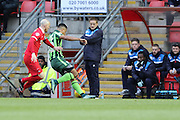 Lyle Taylor of AFC Wimbledon & Sean Clohessy (Captain) of Leyton Orient during Sky Bet League 2 match between Leyton Orient and AFC Wimbledon at the Matchroom Stadium, London, England on 28 November 2015. Photo by Stuart Butcher.