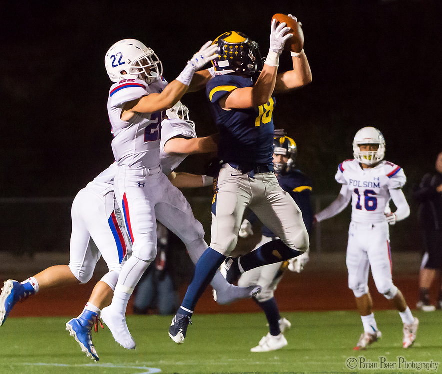 Oak Ridge Trojans Austin Jarrard (18), catches the ball as Folsom Bulldogs Tanner Ward (22), defends during the fourth quarter as the Oak Ridge Trojans football team host the Folsom Bulldogs, Friday Nov 3, 2017.<br /> photo by Brian Baer