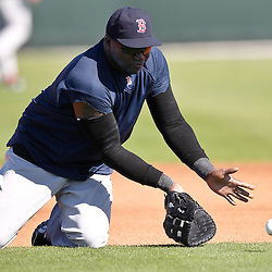 February 19, 2011; Fort Myers, FL, USA; Boston Red Sox first baseman David Ortiz (34) fields a ground ball during spring training at the Player Development Complex.  Mandatory Credit: Derick E. Hingle