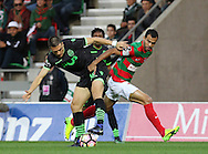 Sporting's player Palhinha (L ) fights for the ball with Maritimo´s player Fransérgio   (R ) during Portuguese First League football match Maritimo vs Sporting held at Barreiros Stadium, Funchal, Portugal, 21 January, 2017.  EPA / GREGÓRIO CUNHA