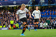 Valencia CF midfielder Daniel Wass (18) shoots towards the goal during the Champions League match between Chelsea and Valencia CF at Stamford Bridge, London, England on 17 September 2019.