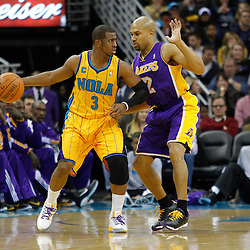 February 5, 2011; New Orleans, LA, USA; New Orleans Hornets point guard Chris Paul (3) is guarded by Los Angeles Lakers point guard Derek Fisher (2) during the third quarter at the New Orleans Arena. The Lakers defeated the Hornets 101-95.  Mandatory Credit: Derick E. Hingle