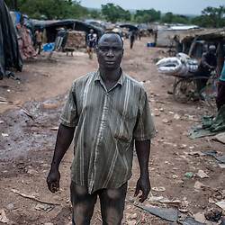 Kari, Burkina Faso - 11 May 2014: Zida Isaka, from the Ivory Coast, the only survivor of an accident caused by heavy rain- fall that killed 8 people on the 8th May, poses for a picture in the village.