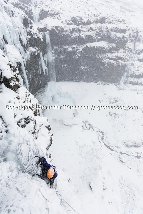 """Róbert Halldórsson on the first ascent of the ice climb """" Drög að sjálfsmorði"""" M7, 35m, at Breiðdalur. East Iceland."""