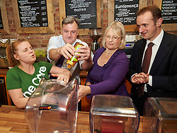 Shadow Chancellor Ed Balls visits  the Core Juice Bar Swindon, United Kingdom, and makes a smoothie with the aid of Erica Fowers the bar manager , Anne Snelgrove the Labour Candidate  for Swindon South and Mark Dempsey the Labour Candidate for Swindon north.Thursday, 28th November 2013. Picture by i-Images