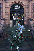 A Christmas tree standing alone outside the now empty Carnegie Library, on 2nd January 2017, in the London borough of Lambeth, England.