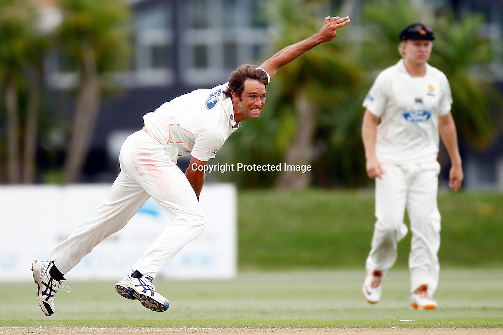 Grant Elliot bowls. Day one of the Plunket Shield cricket - Auckland Aces v Wellington Firebirds at Colin Maiden Park, Auckland, New Zealand on Friday, 24 February 2012. Photo: Ella Brockelsby / photosport.co.nz