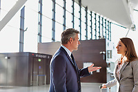 Businessman discussing plans with business partner in airport