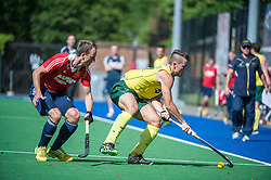Australia's Jeremy Hayward is shadowed by Dan Fox of England. England v Australia, Bisham Abbey, Marlow, UK on 25 May 2014. Photo: Simon Parker