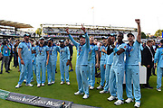 The England players celebrate winning the Cricket World Cup in front of their wives and girl friends on the lap of honour during the ICC Cricket World Cup 2019 Final match between New Zealand and England at Lord's Cricket Ground, St John's Wood, United Kingdom on 14 July 2019.
