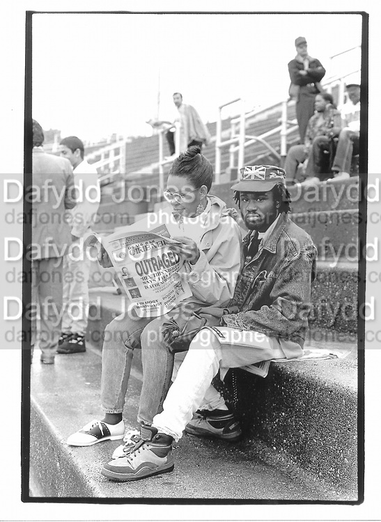 Spectators waiting for a cricket game to start. Pakistan versus the rest of the world. Downing stadium. New York. 1992. © Copyright Photograph by Dafydd Jones 66 Stockwell Park Rd. London SW9 0DA Tel 020 7733 0108 www.dafjones.com