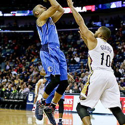 Jan 6, 2016; New Orleans, LA, USA; Dallas Mavericks guard Devin Harris (34) shoots over New Orleans Pelicans guard Eric Gordon (10) during the first quarter of a game at the Smoothie King Center. Mandatory Credit: Derick E. Hingle-USA TODAY Sports