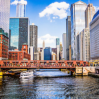 Chicago cityscape at Wells Street Bridge picture along the Chicago River in downtown Chicago.