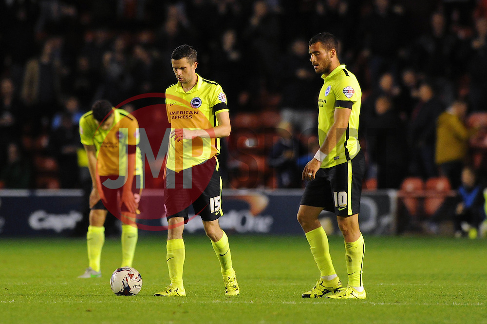 Tomer Hemed of Brighton & Hove Albion (right) and Jamie Murphy (left) cut dejected figures as they go 2-1 down to Walsall in the Capital One Cup - Mandatory byline: Dougie Allward/JMP - 07966386802 - 25/08/2015 - FOOTBALL - Bescot Stadium -Walsall,England - Walsall v Brighton - Capital One Cup - Second Round