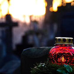 Candle on a grave during the celebration of the All Saint´s Day in the Powazki cemetery, Warsaw, Poland, Europe.