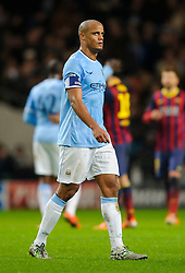 Man City Defender Vincent Kompany (BEL) looks dejected after his sides 0-2 loss - Photo mandatory by-line: Rogan Thomson/JMP - Tel: 07966 386802 - 18/02/2014 - SPORT - FOOTBALL - Etihad Stadium, Manchester - Manchester City v Barcelona - UEFA Champions League, Round of 16, First leg.